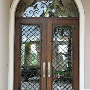 Кованые двери Кованая дверь со стеклом Арт. Д-014 Norkovka